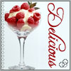 A wine glass full of raspberries and sabayon sauce, with the caption Delicious