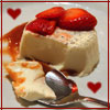 A pannacotta with caramel drizzle and sliced strawberries, with two little heart shapes
